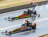 Jul 23, 2017; Morrison, CO, USA; NHRA top fuel driver Leah Pritchett (near) alongside Troy Coughlin Jr during the Mile High Nationals at Bandimere Speedway. Mandatory Credit: Mark J. Rebilas-USA TODAY Sports