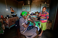Africa, Malkerns, Swaziland, Nest organization artisans project. Nest is partnering with Baobab Batik & local artisans to help market their batik products to global markets and better sustain their local community. Sibongde Zwabe (42)( with her young son,) and her daughter Gacebue (23) both work weaving baskets and products at Gone Rural artisans. Soemtimes they also weave at home as Gacebue has a baby daughter.