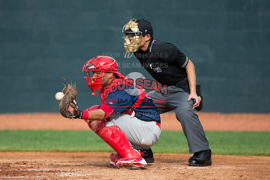 Johnson City Cardinals catcher Chris Chinea (22) catches a pitch as home plate umpire Kaz Endo looks on during the game against the Bristol Pirates at Boyce Cox Field on July 7, 2015 in Bristol, Virginia.  The Cardinals defeated the Pirates 4-1 in game one of a double-header. (Brian Westerholt/Four Seam Images)