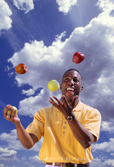 Man juggles apples.