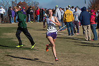 With her competition no where in sight as she approaches the first mile-marker, Eureka senior Hannah Long flies over the course on her way to victory in the Class 4 girls 5k in 17:38 at the 2014 MSHSAA State Cross Country Championship in Jefferson City, MO. Saturday, November 8.