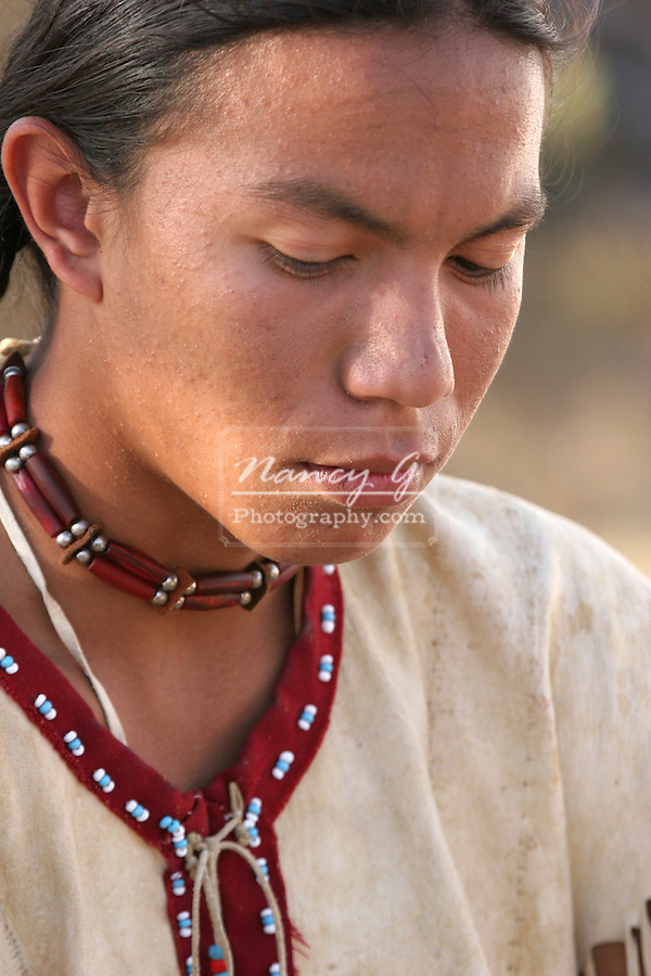A Native American Indian teenage boy looking sad