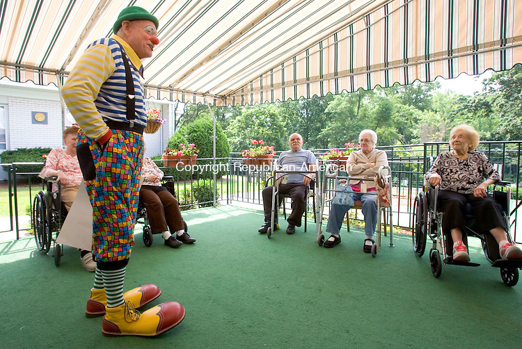 MIDDLEBURY CT. 17 June 2014-061714SV06-Bunky, Bob Gretton, entertains residents at Middlebury Convalescent Home Rehabilitation Service in Middlebury Tuesday. The clowns are goodwill ambassadors for the Cole Bros. Circus. The circus will be in Middlebury on the 25th and 26th of June. <br /> Steven Valenti Republican-American