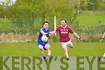 Jimmy Griffin(Ballymacelligott) in action with Donal O'Sullivan (Dromid) in the Div3-5th round of the Football League on Sunday at Ballymacelligott GAA grounds.