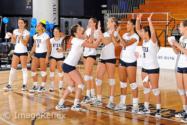13 November 2010:  FIU's Rachel Fernandez (5) high-fives with teammates prior to the game.  The FIU Golden Panthers defeated the South Alabama Jaguars, 3-0 (25-12, 25-12, 25-20), at U.S Century Bank Arena in Miami, Florida.