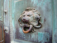 A lion serves as a door handle on the Ile de la Cite in Paris, France.