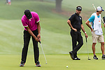 CROMWELL, CT. 20 June 2019-062019 - PGA Tour player Tony Finau putts for birdie on the first hole, as Bubba Watson looks on, during the first round of the Travelers Championship at TPC River Highlands in Cromwell on Thursday. Bill Shettle Republican-American