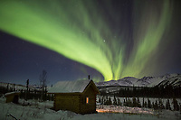Aurora over wolf run cabin in the White Mountains National Recreation Area.