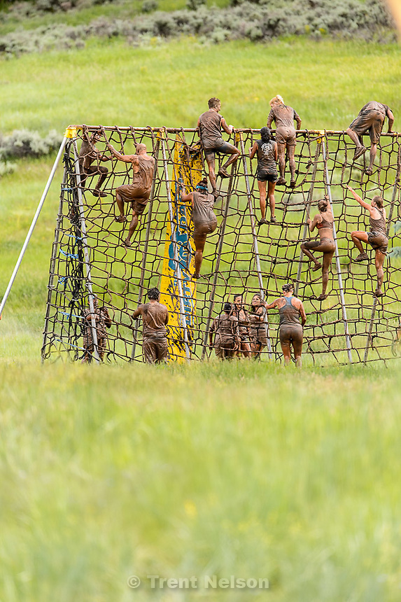 Trent Nelson  |  The Salt Lake Tribune<br /> Runners climb a cargo net at the Dirty Dash, held at Soldier Hollow, Saturday June 6, 2015.