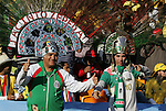 11 JUN 2010: Mexico fans. The South Africa National Team tied the Mexico National Team 1-1 at Soccer City Stadium in Johannesburg, South Africa in the opening match of the 2010 FIFA World Cup.