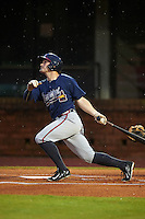 Mississippi Braves outfielder Matt Lipka (7) at bat in the rain during a game against the Mobile BayBears on April 28, 2015 at Hank Aaron Stadium in Mobile, Alabama.  The game was suspended after the top of the second inning with Mobile leading 3-0, the BayBears went on to defeat the Braves 6-1 the following day.  (Mike Janes/Four Seam Images)