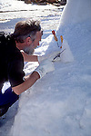 MAN WORKS ON SMALL PIECE OF ICE AT COMPETITION