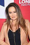 HOLLYWOOD, CA - MARCH 01: Actress Tia Carrere attends the premiere of Focus Features' 'London Has Fallen' held at ArcLight Cinemas Cinerama Dome on March 1, 2016 in Hollywood, California.