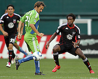 Clyde Simms #19 of D.C. United moves in on Roger Levesque #24 of Seattle Sounders FC during an MLS match at RFK Stadium on July 15 2010, in Washington DC.Seattle won 1-0.