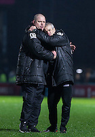 Jim Bentley manager of Morecambe & Assistant Manager Ken McKenna embrace on the final whistle during the Sky Bet League 2 match between Wycombe Wanderers and Morecambe at Adams Park, High Wycombe, England on 2 January 2016. Photo by Andy Rowland / PRiME Media Images