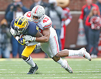 Ohio State Buckeyes linebacker Darron Lee (43) takes down Michigan Wolverines quarterback John O'Korn (5) in the first half at Michigan Stadium on November 28, 2015. (Chris Russell/Dispatch Photo)