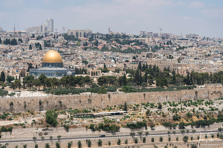 The Dome of the Rock shrine on the Temple Mount or al-Haram ash Sharif in the Old City of Jerusalem, as seen from the Mount of Olives.  Behind the Dome are the Muslim and Christian Quarters.  The Old City of Jerusalem and its Walls is a UNESCO World Heritage Site.