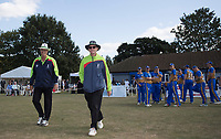Umpires Pip George and Ray Clark lead the fielding side out during Upminster CC vs Essex CCC, Benefit Match Cricket at Upminster Park on 8th September 2019