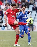 Getafe's Angel Lafita (r) and Osasuna's Damia Abella during La Liga match.December 15,2012. (ALTERPHOTOS/Acero) /NortePhoto