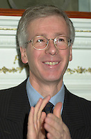 Dec 14,  2001, Montreal, Quebec, Canada<br /> StÈphane Dion, President of the Privy Council and Minister of<br /> Intergovernmental Affairs applaud  as  Claudette Bradshaw, Minister of Labour and Federal and Co-ordinator on Homelessness (Not in the photo)<br /> give a press conference at Chez Doris ( a shelter for homeless women) in presence of it's Director Doris and deputies from the Monrteal area<br /> <br /> Bradshaw spend the day in the Montreal area announcing  funding to address   homelessness in Quebec under the Government of<br /> Canada's National Homelessness Initiative.<br /> <br /> <br />  <br /> <br /> Mandatory Credit: Photo by Pierre Roussel- Images Distribution. (©) Copyright 2001 by Pierre Roussel <br /> ON SPEC<br /> NOTE l Nikon D-1 jpeg opened with Qimage icc profile, saved in Adobe 1998 RGB.