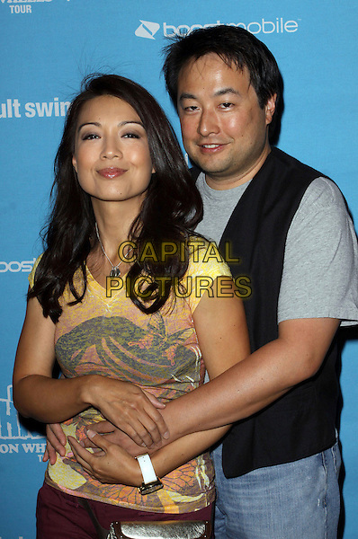 "MING-NA & ERIC MICHAEL ZEE .Adult Swim Presents ""Robot Chicken's Skate Party Bus Tour"" held At SkateLand, Northridge, California, USA, 01 August 2009..half length married husband wife yellow top t-shirt  .CAP/ADM/KB.©Kevan Brooks/Admedia/Capital Pictures"