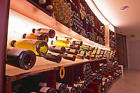 A curved display of bottles. Backlit The Lavinia wine shop in Paris. Probably the biggest wine shop in Paris, with its special temperature controlled section for wines that are fragile and must be stored at cool low temperature.