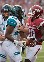 NWA Democrat-Gazette/CHARLIE KAIJO Coastal Carolina Chanticleers running back Alex James (22) reacts following a score during a football game on Saturday, November 4, 2017 at Razorback Stadium in Fayetteville