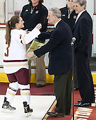 Erin Kickham (BC - 3), Tom Peters (BC - Senior Associate AD), Brad Bates (BC - AD) -  The Boston College Eagles defeated the visiting Boston University Terriers 5-0 on BC's senior night on Thursday, February 19, 2015, at Kelley Rink in Conte Forum in Chestnut Hill, Massachusetts.