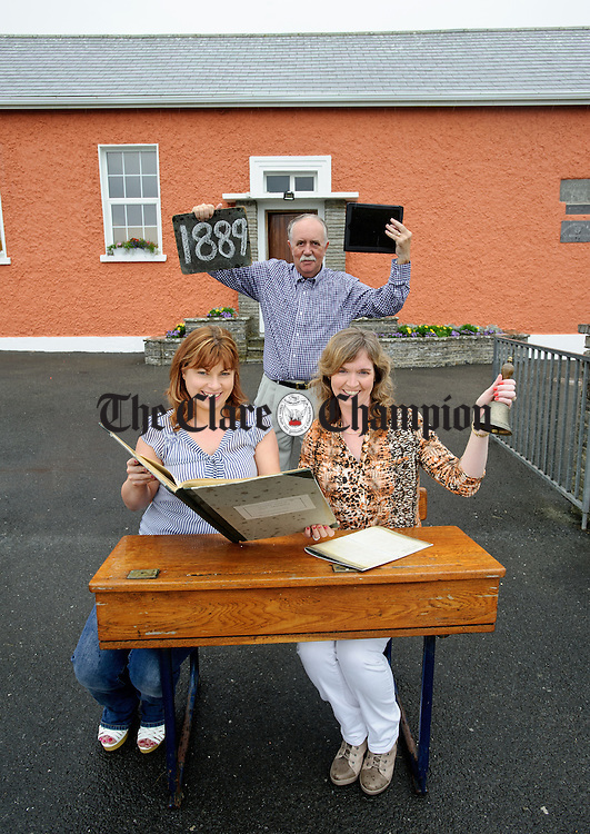 Preparing for the 125th anniversary celebrations of Clohanes National School were Mary Rita Flynn, resource teacher and  Aideen O Mahoney, principal with Mick Carrick, chairperson of the 125 committee. Photograph by John Kelly.