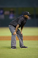 Umpire Darrell Roberts handles the calls on the bases during the South Atlantic League game between the Hickory Crawdads and the Kannapolis Intimidators at Kannapolis Intimidators Stadium on April 22, 2017 in Kannapolis, North Carolina.  The Intimidators defeated the Crawdads 10-9 in 12 innings.  (Brian Westerholt/Four Seam Images)