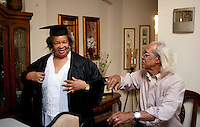 Burlyce Sherrell Logan (cq), a 73-year old woman who is graduating from the University of North Texas, tries on her graduation regalia with the help of her husband Raymond Logan (cq) at home in Denton, Texas, Friday, May 6, 2011. Burlyce first attended the university in 1956, as part of.the group of African-Americans who were integrating it, but the atmosphere was so hostile she dropped out...Photo by Matt Nager