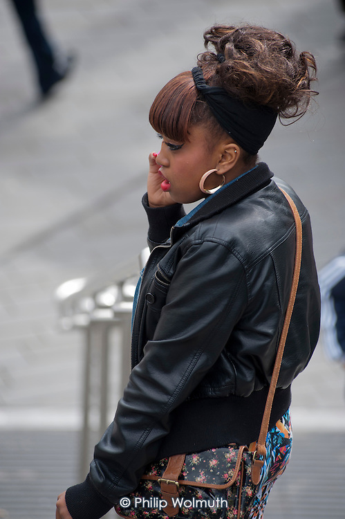 A teenage girl with a mobile phone in Startford, London.
