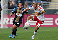CHESTER, PA - OCTOBER 27, 2012:  Danny Cruz (44) of the Philadelphia Union moves up on  Joel Lindpere (20) of the New York Red Bulls during an MLS match at PPL Park in Chester, PA. on October 27. Red Bulls won 3-0.