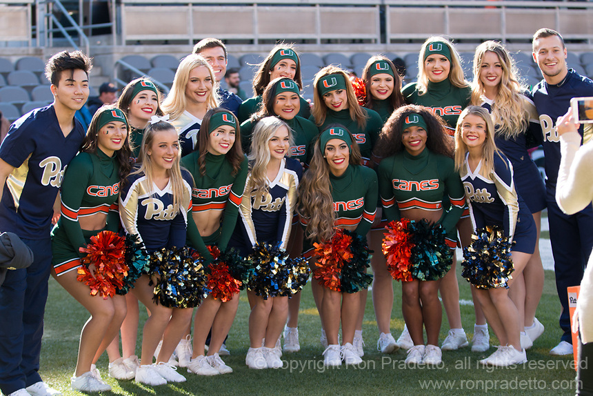 A group picture taken before the game of the Miami cheerleaders and the Pitt cheerleaders. The Pitt Panthers upset the undefeated Miami Hurricanes 24-14 on November 24, 2017 at Heinz Field, Pittsburgh, Pennsylvania.