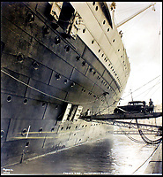 BNPS.co.uk (01202 558833)<br /> Pic:    CanterburyAuctionGalleries/BNPS<br /> <br /> A car is loaded onto the huge ship.<br /> <br /> Remarkable photos of the iconic ocean liner SS Normandie which was like a 'floating palace' have come to light over 80 years later.<br /> <br /> The giant 1,000ft long French passenger ship was the largest of her type in the world and won the coveted 'Blue Riband' for the fastest crossing of the Atlantic.<br /> <br /> English photographer Percy Byron's photos show the liner's luxurious 'Art Deco' interior with its chandeliers and pillars of Lalique glass.<br /> <br /> The vessel, which launched in 1935, even boasted its own swimming pool and a gym where young women can be seen doing aerobics while a man in a suit trains with a punch bag.