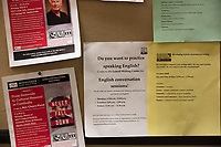 "Event posters, including one reading ""Do you want to practice speaking English,"" hang on a bulletin board  at Middlesex Community College's Asian American Connections Center on Thurs., Feb. 15, 2018. The Asian American Connections Center was established at the school using a federal grant in 2016 and serves as a focal point for the Asian community at the school, predominantly Cambodian, to gather, socialize, study, and otherwise take part in student life."
