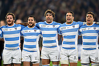 Julian Montoya, Horacio Agulla, Juan Martin Fernandez Lobbe, Juan Manuel Leguizamon and Facundo Isa of Argentina sings their national anthem. Rugby World Cup Bronze Final between South Africa and Argentina on October 30, 2015 at The Stadium, Queen Elizabeth Olympic Park in London, England. Photo by: Patrick Khachfe / Onside Images
