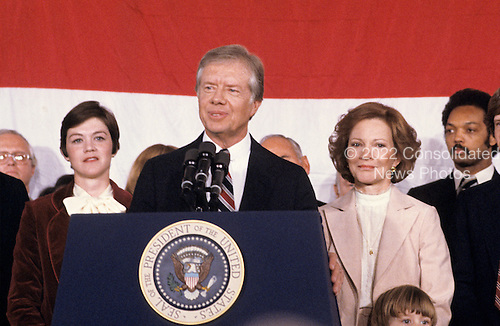 """United States President Jimmy Carter makes remarks conceding the election to Republican Ronald Reagan at the Sheraton Washington Hotel in Washington, DC on November 4, 1980.  First lady Rosalynn Carter and the Reverend Jesse Jackson can be seen at right.<br /> Credit: Benjamin E. """"Gene"""" Forte / CNP"""