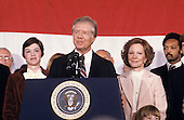 United States President Jimmy Carter makes remarks conceding the election to Republican Ronald Reagan at the Sheraton Washington Hotel in Washington, DC on November 4, 1980.  First lady Rosalynn Carter and the Reverend Jesse Jackson can be seen at right.<br /> Credit: Benjamin E. &quot;Gene&quot; Forte / CNP