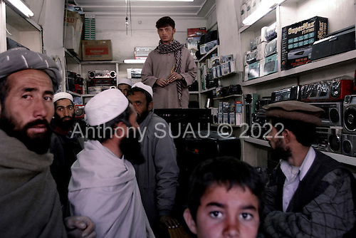Kabul, Afghanistan<br /> November 2001<br /> <br /> An electronics store is busy after the fall of the Taliban who forbid TVs or radios to be used or owned.