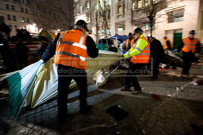 28/02/2012. LONDON, UK. Workers remove tents as bailiffs and police evict Occupy London protesters from their campsite. After being camped outside St Paul's Cathedral in London for four months anti-capitalist Occupy London demonstrators were tonight evicted by police and bailiffs who moved in shortly after midnight. Photo credit: Matt Cetti-Roberts