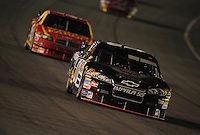 Aug 31, 2008; Fontana, CA, USA; NASCAR Sprint Cup Series driver Regan Smith (01) leads Kyle Petty during the Pepsi 500 at Auto Club Speedway. Mandatory Credit: Mark J. Rebilas-
