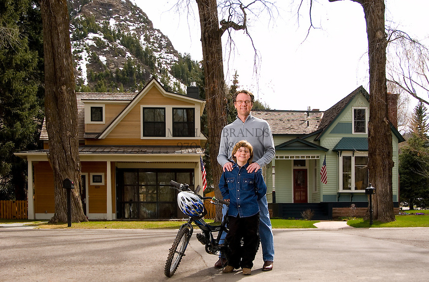 A father and son outside their Aspen home, left. The home was remodeled following strict historic guidelines. © Michael Brands. 970-379-1885.