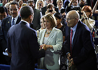 United States President Barack Obama greets House Minority Leader Nancy Pelosi (Democrat of California) following his speach to automakers on efforts to improve fuel efficiency in cars and light trucks starting in 2017 at the Walter E. Washington Convention Center, in Washington, Friday, July 29, 2011. At right is Rep. John Dingell (Democrat of Michigan). Credit: Martin Simon/CNP/AdMedia