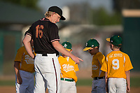 Modesto Nuts starting pitcher Darren McCaughan (16) stands on the pitchers mound with local young baseball players before the National Anthem at a California League game against the Lake Elsinore Storm at John Thurman Field on May 11, 2018 in Modesto, California. Modesto defeated Lake Elsinore 3-1. (Zachary Lucy/Four Seam Images)