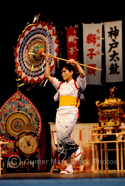 Female Japanese Dancer from Ikuta Shinto Shrine in Japan wearing a Kimono and dancing Traditional Parasol Dance Performance on Stage (No Model Release Available)