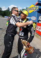 Jun 6, 2016; Epping , NH, USA; NHRA top fuel driver Antron Brown celebrates with a crew member after winning the New England Nationals at New England Dragway. Mandatory Credit: Mark J. Rebilas-USA TODAY Sports