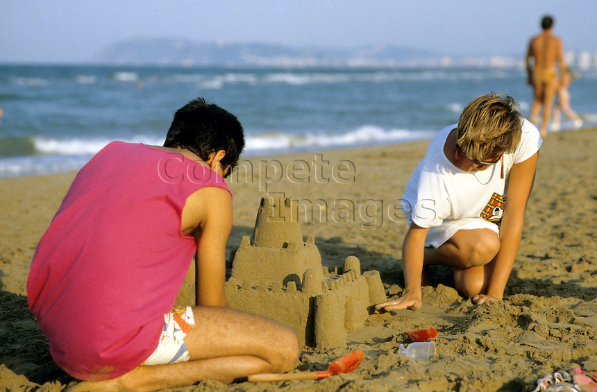 Man and woman building a sandcastle