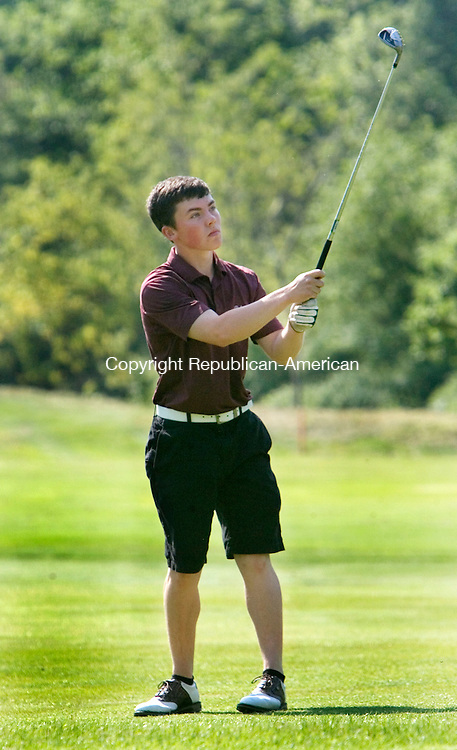 WATERTOWN CT. 30 May 2013-053013SV08-Seth Thompson, 18, of Torrington High watches his fairway shot on 7 during the NVL Golf Championships at the Watertown Golf Club in Watertown Thursday.<br /> Steven Valenti Republican-American