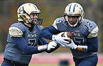 Althoff quarterback Hayes Taylor (7, left) hands off to wide receiver Melvin Brock in the first half. The Althoff Catholic High School Crusaders defeated the Carterville Lions 42-0 in a first-round Illinois High School Association Class 4A football playoff game on Saturday October 28, 2017 in Belleville.